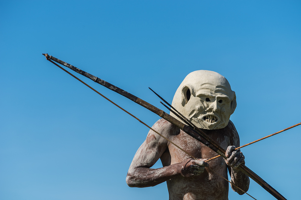 Goroko Mudman with bow and arrow, Madang Festival, PNG