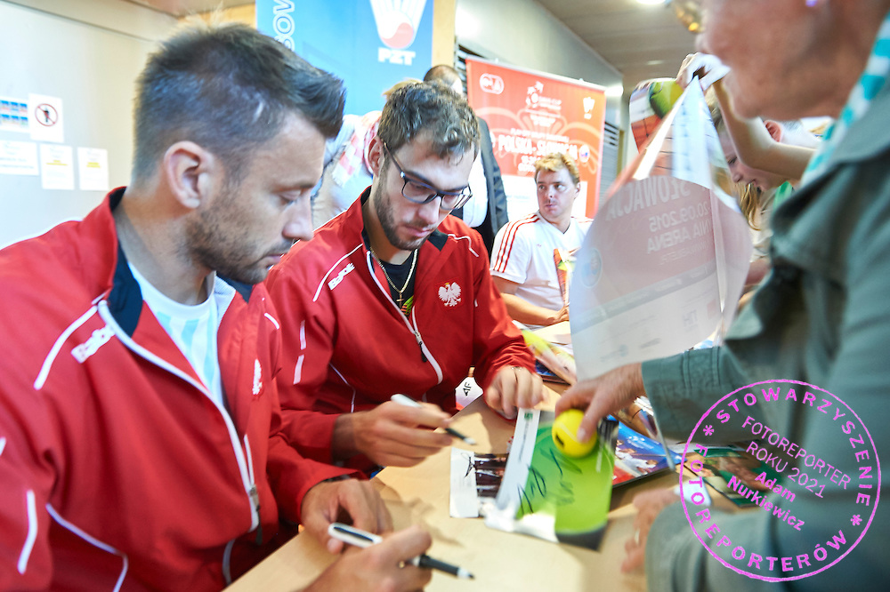(L-R) Michal Przysiezny and Jerzy Janowicz and Marcin Matkowski all from Poland while their autographs session during Davis Cup Tie World Group Play-off Poland v Slovakia at Gdynia Arena Hall in Gdynia, Poland.<br /> <br /> Poland, Gdynia, September 19, 2015<br /> <br /> Picture also available in RAW (NEF) or TIFF format on special request.<br /> <br /> For editorial use only. Any commercial or promotional use requires permission.<br /> <br /> Adam Nurkiewicz declares that he has no rights to the image of people at the photographs of his authorship.<br /> <br /> Mandatory credit:<br /> Photo by &copy; Adam Nurkiewicz / Mediasport