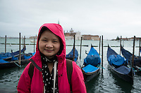 Asian Female Tourist on Cold Day in San Marco, Venice, Italy