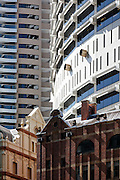 Detail of Grosvenor Place tower, and 1912 brick building Sydney, Australia.