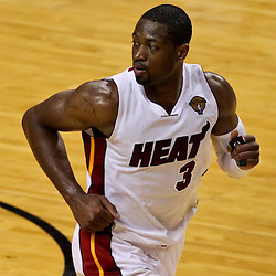 Jun 21, 2012; Miami, FL, USA; Miami Heat shooting guard Dwyane Wade (3) against the Oklahoma City Thunder during the fourth quarter in game five in the 2012 NBA Finals at the American Airlines Arena. Mandatory Credit: Derick E. Hingle-US PRESSWIRE