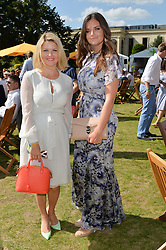 Left to right, MARIYA DYKALO and LADY NATASHA RUFUS-ISAACS at the Summer Solstice Party during the Boodles Tennis event hosted by Beulah London and Taylor Morris at Stoke Park, Park Road, Stoke Poges, Buckinghamshire on 21st June 2014.
