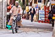 old man on moped in marrakech. morocco.
