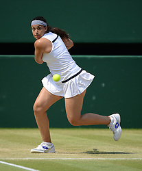 © Licensed to London News Pictures. 7/07/2013. Wimbledon Tennis Championships, London, UK. Ladies singles final Marion Bartoli (dark hair) of France defeats Sabine Lisicki, Germany (blonde hair) to become the Ladies Champion. She has announced her immediate retirement from Tennis on 14/08/2013.. Photo credit : Mike King /LNP