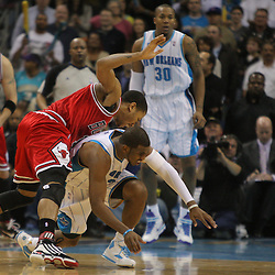 Jan 29, 2010; New Orleans, LA, USA; Chicago Bulls guard Derrick Rose (1) and New Orleans Hornets guard Chris Paul (3) collide during the fourth quarter at the New Orleans Arena. The Bulls defeated the Hornets 108-106 in overtime. Mandatory Credit: Derick E. Hingle-US PRESSWIRE