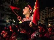 09 NOVEMBER 2015 - YANGON, MYANMAR: People watch the announcement of vote results at NLD headquarters Monday. Thousands of National League for Democracy (NLD) supporters gathered at NLD headquarters on Shwegondaing Road in central Yangon to celebrate their apparent landslide victory in Myanmar's national elections that took place Sunday. The announcement of official results was delayed repeatedly Monday, but early reports are that the NLD did very well against the incumbent USDP.     PHOTO BY JACK KURTZ