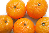 Close-up of fresh oranges over white background