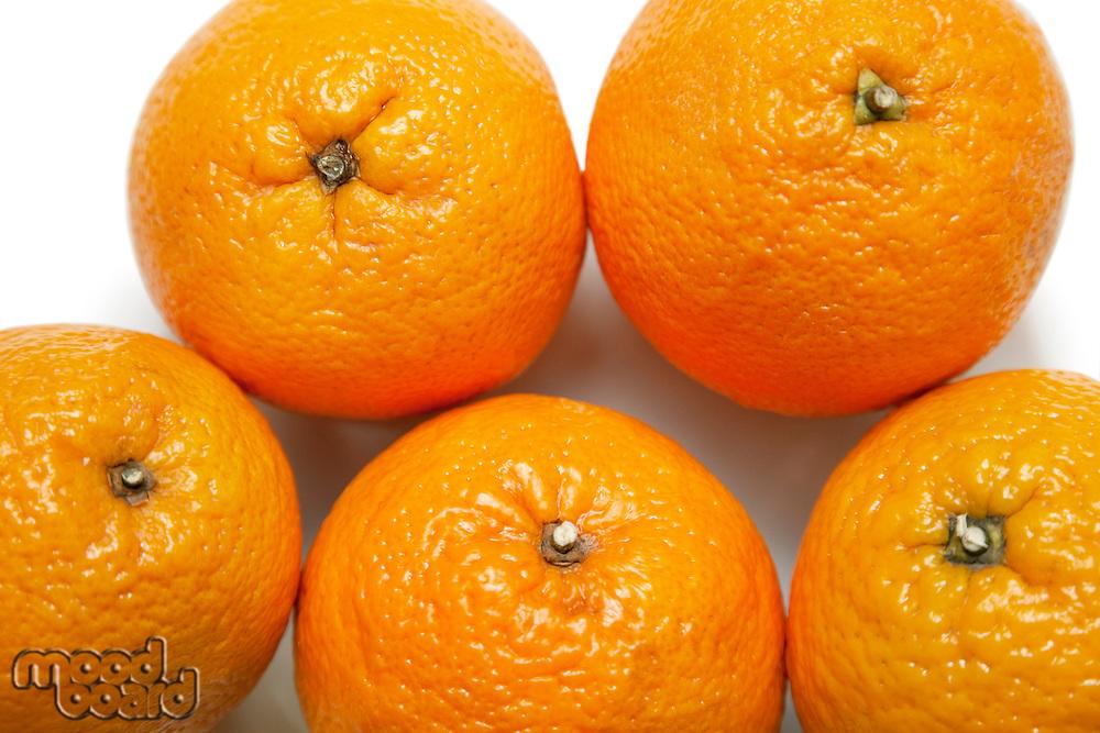 Close-up of fresh oranges over white background
