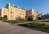 Main building of Lednice Castle in south Bohemia in the Czech Republic, Europe. Early morning sun lights up the building on a spring morning.