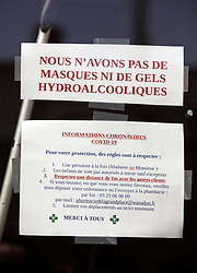 23 March 2020. Montreuil Sur Mer, Pas de Calais, France. <br /> Coronavirus - COVID-19 in Northern France.<br /> <br /> Signs in shop windows indicating businesses are closed or offering alternative arrangements and opening hours as the coronavirus pandemic locks down France. <br /> <br /> From March 16th French lawmakers imposed strict controls on the movement of people in an effort to stem the spread of the virus. Anyone leaving their home must carry with them an 'attestation,' in a effect a self administered permit to allow them out of the house. If stopped by the police, one must produce a valid permit along with identification papers. Failure to do so is punishable with heavy fines. Movement in France has been heavily restricted by the government.<br /> <br /> Montreuil Sur Mer was the headquarters of the British Army under Field-Marshal Sir Douglas Haig from March 1916 to April 1919. Over 1,200 year old, the ancient fortified  town with its high ramparts has endured through history, surviving the plague and King Henry VIII's invasion of France in 1544 when the Duke of Norfolk under Henry VIII's command laid a disastrous siege to the town which held firm until Norfolk was forced to withdraw in 1545. Residents are confident the ancient town can survive the coronavirus too. <br /> Photo©; Charlie Varley/varleypix.com