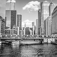 Chicago Wells Street Bridge black and white picture. Photo includes Chicago River, Trump Tower, Marina City Towers, Hotel 71, and the United Airlines building.
