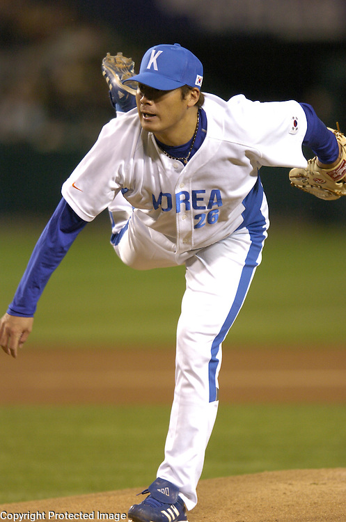 Team Korea's starter Jae Wong Seo throws in the 1st Inning against Team Mexico in Round 2 action at Angel Stadium of Anaheim.