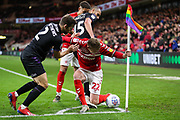 Middlesbrough midfielder George Saville (22) takes the ball to the corner under pressure from Charlton Athletic defender Adam Matthews (2) and Charlton Athletic midfielder Darren Pratley (15) during the EFL Sky Bet Championship match between Middlesbrough and Charlton Athletic at the Riverside Stadium, Middlesbrough, England on 7 December 2019.