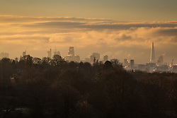 "The first rays of the sun illuminate Londons skyscrapers and clouds to the south of the city. The threatened snow from ""The Beast From The East"" weather system doesn't materialise overnight in London leaving a crisp, clear morning, seen from Hampstead Heath in North London. London, February 27 2018."