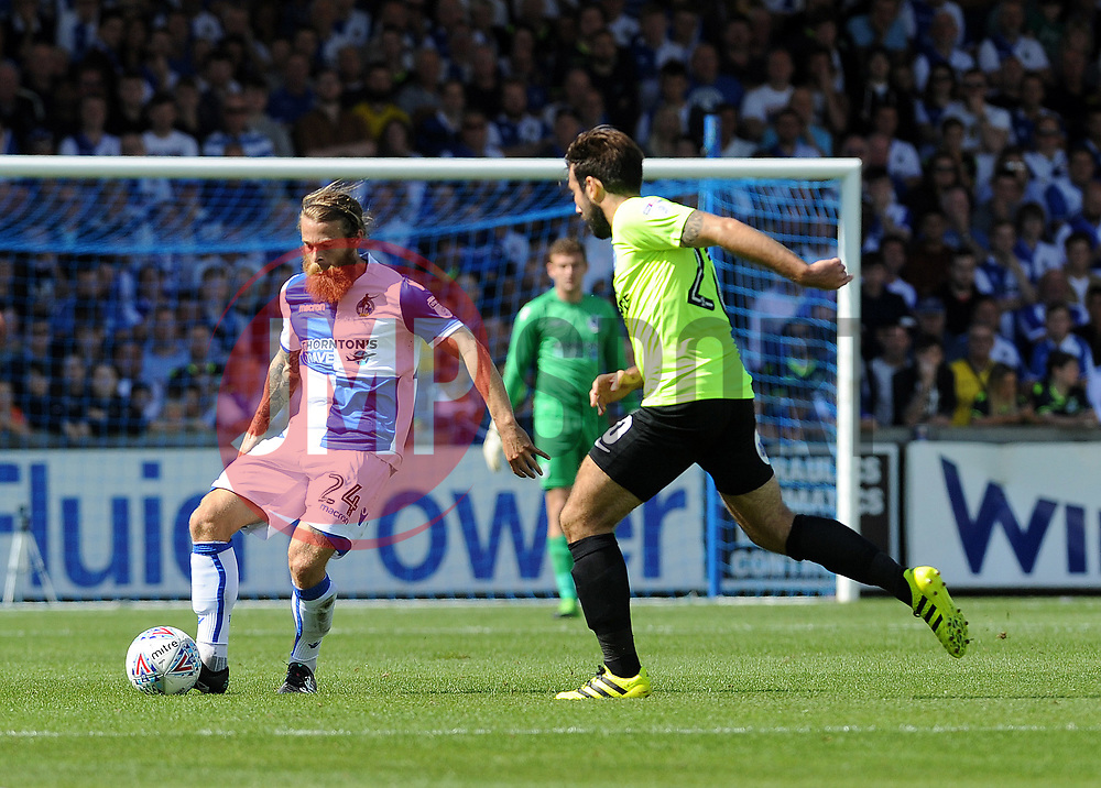 Stuart Sinclair of Bristol Rovers is challenged by Michael Doughty of Peterborough United - Mandatory by-line: Neil Brookman/JMP - 12/08/2017 - FOOTBALL - Memorial Stadium - Bristol, England - Bristol Rovers v Peterborough United - Sky Bet League One