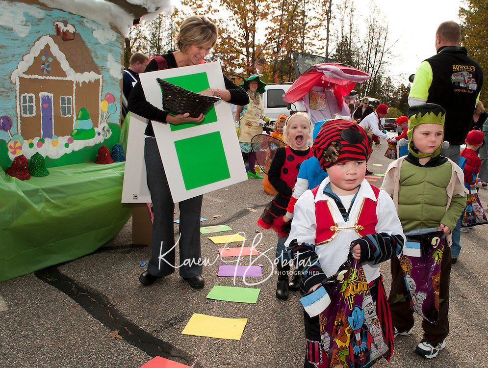 "Carter Jones wanders through ""Candy Land"" decorated by Ms. Mint (Mandie Hagan) Gramma Nut (Debbie Rowell),  Chris Harris and Jodie Gallant as playing cards during Holy Trinity School's ""Trunk or Treat"" Monday afternoon.  (Karen Bobotas/for the Laconia Daily Sun)"
