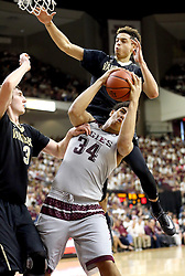 Texas A&M's Tyler Davis (34) fights for a ball against Vanderbilt's Luke Kornet and Wade Baldwin IV (5) during the first half of an NCAA college basketball game, Saturday, March 5, 2016, in College Station, Texas. (AP Photo/Sam Craft)