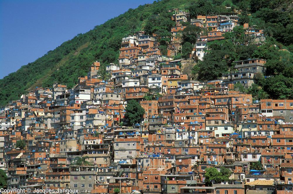 Slum callled favela in Brazil on Morro do Pavao hill , Rio de Janeiro, Brazil.
