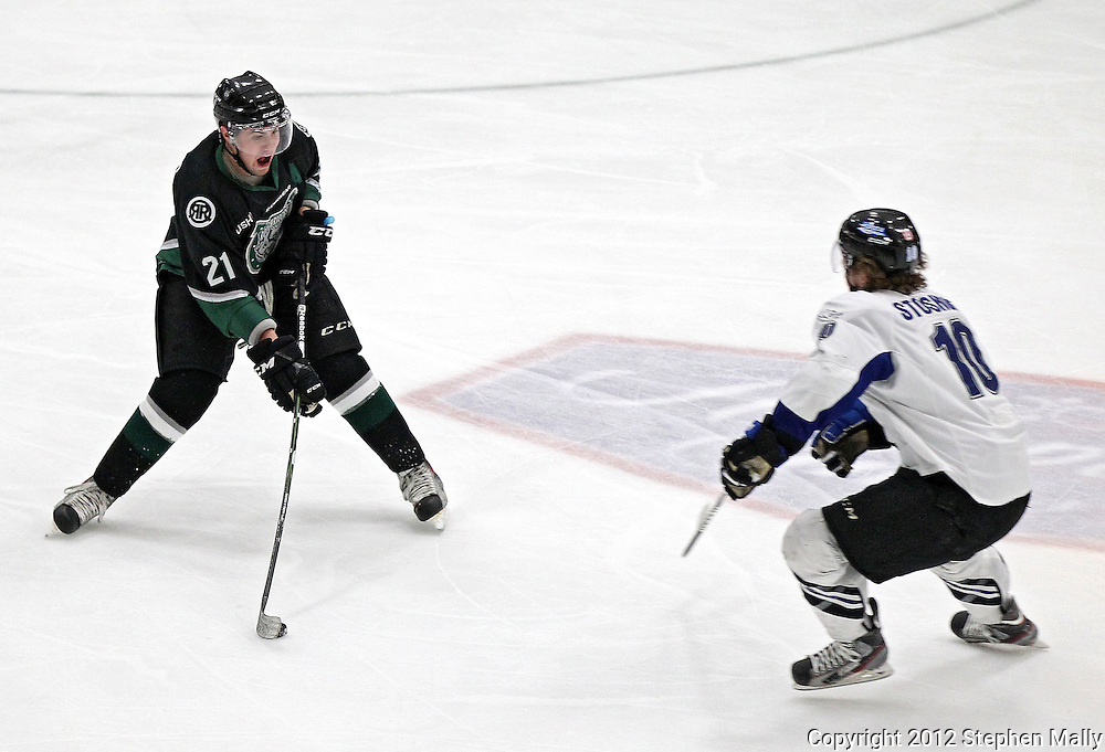 Roughriders' Greg Amlong (21) tries to pass around Force's Nick Stoskopf (10) during their game at the Cedar Rapids Ice Arena, 1100 Rockford Road SW in Cedar Rapids on Saturday evening, February 18, 2012. (Stephen Mally/Freelance)