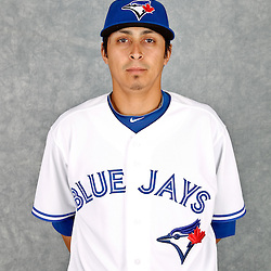March 2, 2012; Dunedin, FL, USA; Toronto Blue Jays relief pitcher Jesse Chavez (20) poses for a portrait during photo day at Florida Auto Exchange Stadium.  Mandatory Credit: Derick E. Hingle-US PRESSWIRE