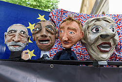 © Licensed to London News Pictures. 09/06/2017. London, UK. Puppets depicting (L to R) Jeremy Corbyn, Nigel Farage, Tim Farron and Theresa May are seen in front of the European Flag and Union Jack flags.  Anti-Tory protesters demonstrate outside Downing Street on the day that the General Election results produced a hung Parliament.  A variety of different groups, from LGBT supporters to Save the NHS supporters, gathered to make their views heard. Photo credit : Stephen Chung/LNP
