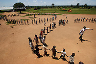 October 6, 2006 - Children dance in circles at a day care center in Coope camp for internally displaced people, or IDP, near Gulu in north Uganda. Coope, with a population of 18,000, is one of 76 IDP camps around Gulu, the main base for the Uganda Peoples Defense Force fighting the insurgent Joseph Kony's Lord's Resistance Army. Kony's LRA movement has been fighting for the past 20 years to force the East African country to be ruled according to the Christian Ten Commandments. Over 2 million people, mostly of the Acholi tribe, have moved or were forced to move from their villages to camps close to the towns of Gulu, Lira, and Kitgum where they are watched over by the Ugandan Army. The LRA rebels have abducted thousands of children and have forced them to fight against the Ugandan Army and the Acholi people. Current peace talks between Kony's LRA and the Ugandan government held in Juba, southern Sudan, offer a glimpse of hope to ending this ongoing conflict..(Photo by Jakub Mosur/Polaris)<br />