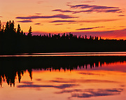 Canada, Manitoba, View of sunrise over Childs Lake at Duck Mountain Provincial Park