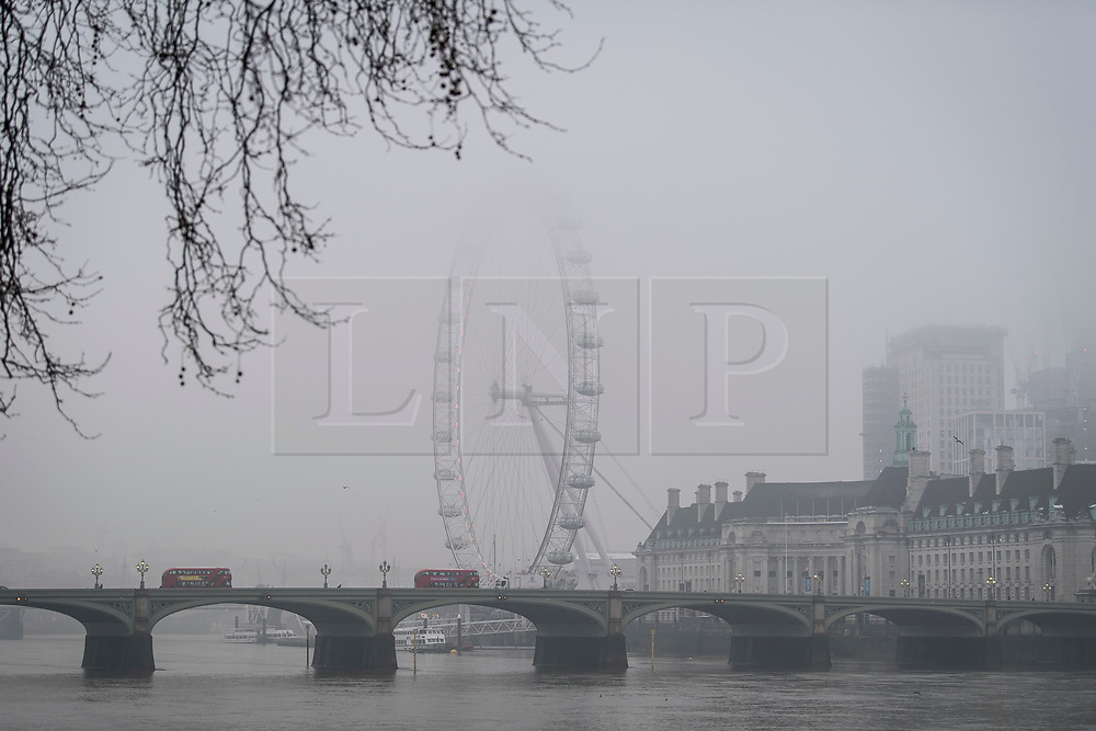© Licensed to London News Pictures. 03/03/2018. London, UK. Mist shrouds the London Eye and Westminster Bridge on another freezing morning in the capital. Large parts of the UK are recovering from a week of sub zero temperatures and heavy snowfall, following two severe cold fronts. Photo credit: Ben Cawthra/LNP