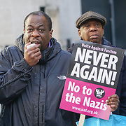 A protester holds a sign reading 'Never again! No to the Nazis' as United Against Fascism supporters protest against BBC for interviewing French far-right leader Marine Le Pen on the BBC's 'Andrew Marr Show on Remembrance Sunday, November 13, 2016.<br />