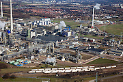 Nederland, Limburg, Gemeente Sittard-Geleen., 07-03-2010; Chemelot,  complex voor chemische industrie in westelijke mijnstreek, huisvest onder andere DSM (De Staatsmijnen, Dutch State Mines). Detail van het complex, .tankwagens voor vervoer van chemicalien per spoor in de voorgrond. Huizen van Geleen in de achtergrond..Chemelot complex for chemical industry in former western mining district, home to DSM (Dutch State Mines)..Detail of the complex, tankers for transporting chemicals by rail in the foreground. Houses of Geleen in the background..luchtfoto (toeslag), aerial photo (additional fee required).foto/photo Siebe Swart