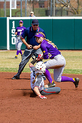 NORMAL, IL - April 06:  Umpire Bryan Smith observes a play at 2nd with Shannon Felde sliding in during a college women's softball game between the ISU Redbirds and the University of Northern Iowa Panthers on April 06 2019 at Marian Kneer Field in Normal, IL. (Photo by Alan Look)