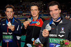 28-11-2010 Swimming, EUROPEAN SHORT COURSE CHAMPIONSHIPS: EINDHOVEN 2010: Peter Mankoc SLO win the silver medal (R) 100m individuel medley, gold for Markus Deibler GER and bronze Alan Cabello Fornsy /  Photo by Ronald Hoogendoorn / SPORTIDA PHOTO AGENCY