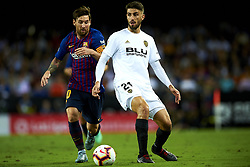 October 8, 2018 - Valencia, Valencia, Spain - Cristiano Piccini, Lionel Messi battle for the ball during the week 8 of La Liga match between Valencia CF and FC Barcelona at Mestalla Stadium in Valencia, Spain on October 7, 2018. (Credit Image: © Jose Breton/NurPhoto/ZUMA Press)