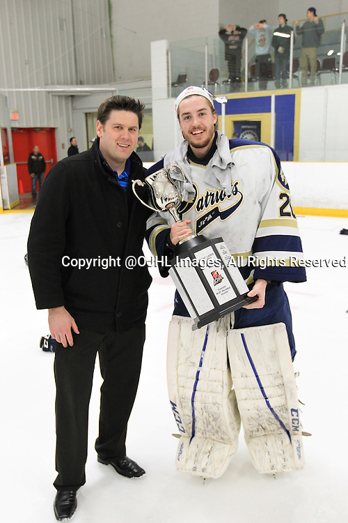 TORONTO, ON - Apr 22, 2015 : Ontario Junior Hockey League game action between the Toronto Patriots and the Kingston Voyageurs. Game seven of the Buckland Cup Championship Series. Patriots goaltender Mathew Robson #20 poses with the Patriots Goaltender Coach.<br /> (Photo by Tim Bates / OJHL Images)