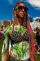 Black woman with marijuana body paint, 420 Cannabis Culture Music Festival, Civic Center Park, Downtown Denver, Colorado USA. This was the first 4/20 celebration since recreational pot became legal in Colorado January 1, 2014. A crowd of up to 80,000 people attended the event.
