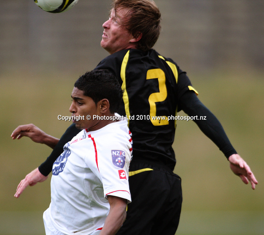 Adam Birch beats Waitakere striker Roy Krishna to a header.<br /> NZFC soccer  - Team Wellington v Waitakere United at Newtown Park, Wellington. Sunday, 4 April 2010. Photo: Dave Lintott/PHOTOSPORT