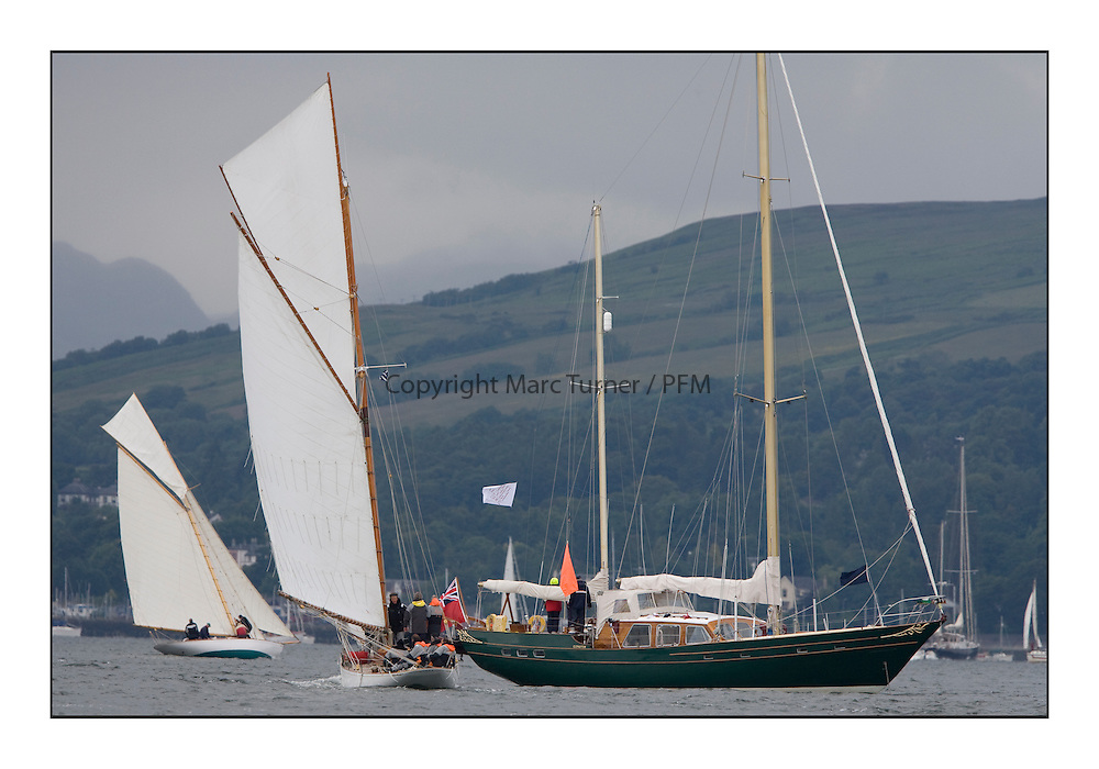 Glenafton the Official Commitee Boat...Overcast day for sailors heading south from Rhu to Rothesay...* The Fife Yachts are one of the world's most prestigious group of Classic .yachts and this will be the third private regatta following the success of the 98, .and 03 events.  .A pilgrimage to their birthplace of these historic yachts, the 'Stradivarius' of .sail, from Scotland's pre-eminent yacht designer and builder, William Fife III, .on the Clyde 20th -27th June.   . ..More information is available on the website: www.fiferegatta.com . .Press office contact: 01475 689100         Lynda Melvin or Paul Jeffes