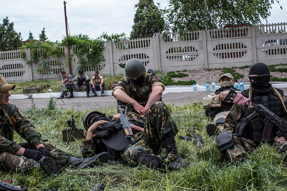 PISKY, UKRAINE - MAY 23: Members of the pro-Russia Vostok Battalion assemble along the side of the road following early morning clashes with pro-Ukraine fighters on May 23, 2014 in Pisky, Ukraine. At least eight people between the two sides, including one civilian, were killed in an early morning firefight when the Donbass Battalion, a pro-Ukraine militia, attacked a Vostok Battalion checkpoint in the nearby town of Karlivka. (Photo by Brendan Hoffman/Getty Images) *** Local Caption ***