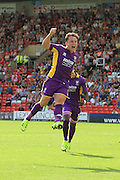 Jack Munns celebrates his first and the opening goal during the Vanarama National League match between Lincoln City and Cheltenham Town at Sincil Bank, Lincoln, United Kingdom on 8 August 2015. Photo by Antony Thompson.
