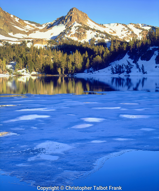 I had to hike two miles into the wilderness to get my photo of a partially frozen Skelton Lake in the Sierra Nevada Mountains.  The mountain peak and forest rise above the deep blue ice foreground.