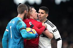 Fulham's Aleksandar Mitrovic (right) exchanges words with Manchester United's Chris Smalling, David de Gea and Phil Jones during the Premier League match at Craven Cottage, London.