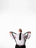 Overweight businessman stretching braces