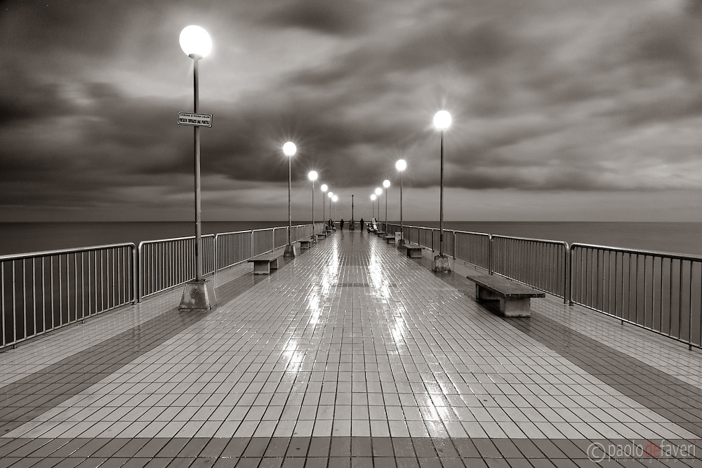The pier of Pietra Ligure in Liguria, Italy. Taken at dusk under some heavy rain.