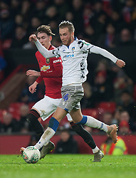 Ben Stevenson of Colchester United (R) and James Garner of Manchester United in action - Mandatory by-line: Jack Phillips/JMP - 18/12/2019 - FOOTBALL - Old Trafford - Manchester, England - Manchester United v Colchester United - English League Cup Quarter Final