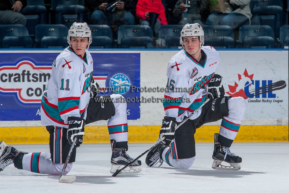 KELOWNA, CANADA - FEBRUARY 27: Jordan Borstmayer #11 and Kole Lind #16 of Kelowna Rockets stretch on the ice during warm up against the Spokane Chiefs on February 27, 2016 at Prospera Place in Kelowna, British Columbia, Canada.  (Photo by Marissa Baecker/Shoot the Breeze)  *** Local Caption *** Jordan Borstmayer; Kole Lind;