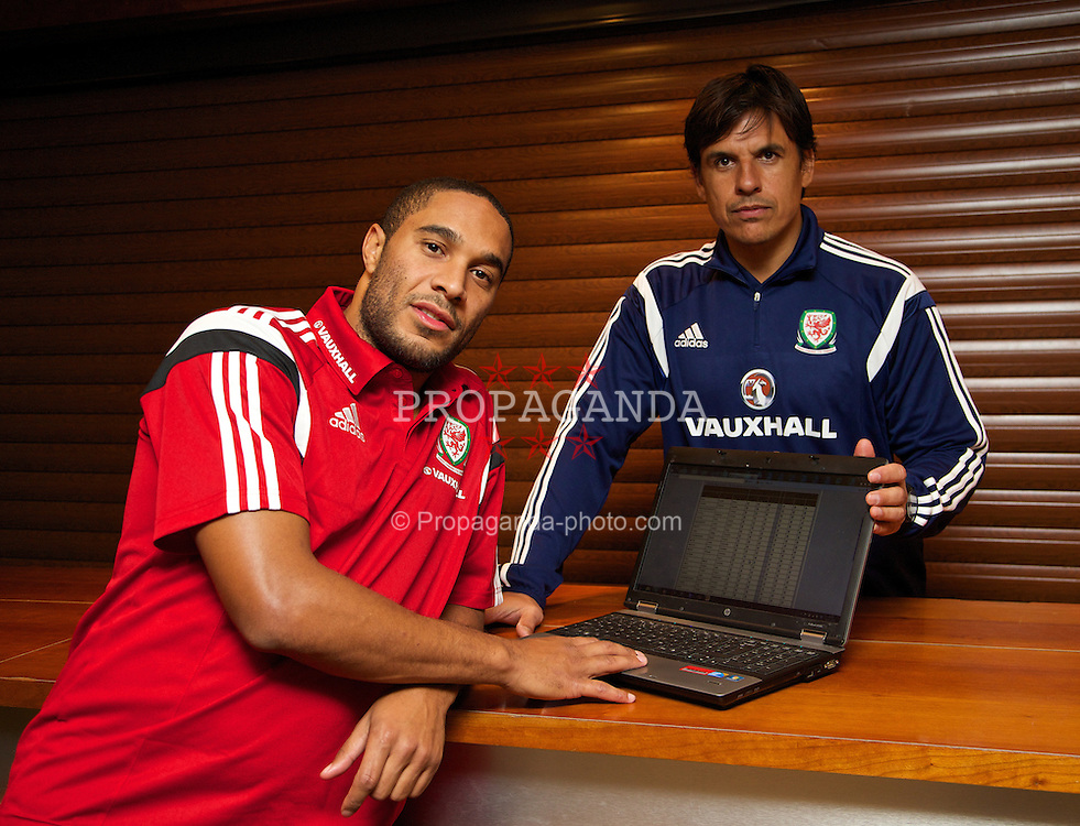CARDIFF, WALES - Wednesday, November 13, 2013: Wales' manager Chris Coleman and captain Ashley Williams vote for his FIFA Ballon d'Or Player of the Year online at the St. David's Hotel ahead of the international friendly match against Finland. (Pic by David Rawcliffe/Propaganda)