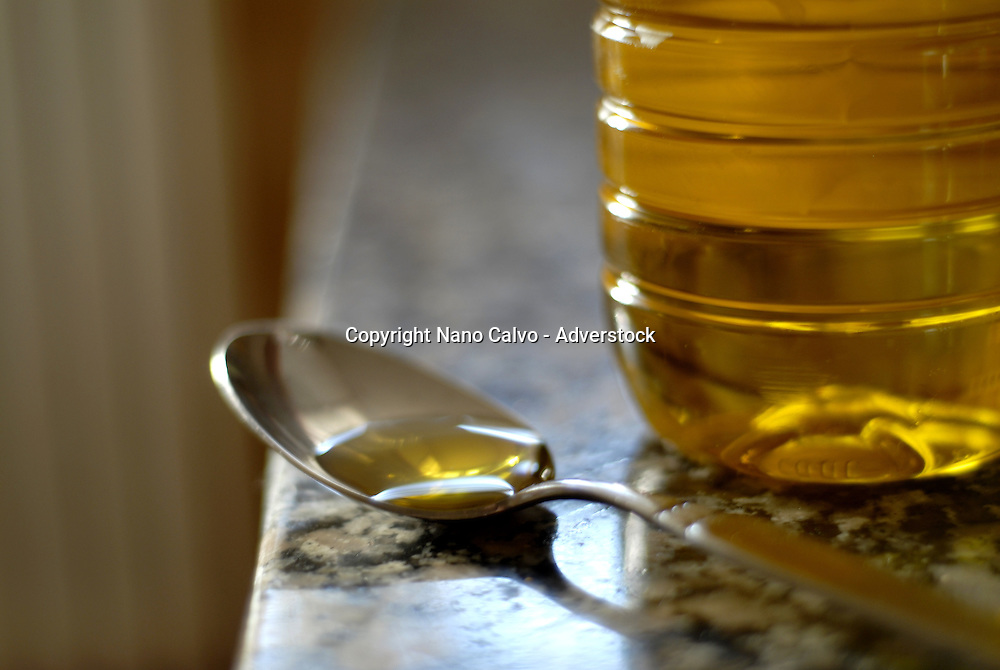 Spanish olive oil in a bottle and in a spoon