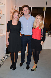 Left to right, PRINCESS BEATRICE VON PREUSSEN, CHRISTOPHER RAYMOND and PHOEBE DICKINSON at an exhibition of works by Beatrice von Preussen held at The Gallery on The Corner, 155 Battersea Park Road, London SW8 on 11th December 2013.