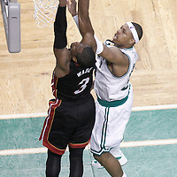 03 June 2012: Miami Heat shooting guard Dwyane Wade (3) dunks the ball over Boston Celtics small forward Paul Pierce (34) during the Boston Celtics 93-91 overtime victory over the Miami Heat, in Game 4 of the Eastern Conference Finals playoff series, at the TD Banknorth Garden, Boston, Massachusetts, USA.