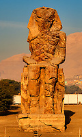 view of the Colossus of Memnon representing Amenhotep III in luxor upper egypt